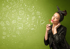 Cute girl blowing hand drawn media icons and symbols Stock Image