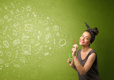 Cute girl blowing hand drawn media icons and symbols Royalty Free Stock Photos