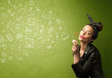 Cute girl blowing hand drawn media icons and symbols Stock Images