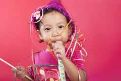 Cute girl blowing party horn Royalty Free Stock Photography