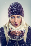 Cute Girl Blowing Snowflakes Royalty Free Stock Images