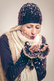 Cute Girl Blowing Snowflakes Royalty Free Stock Photos