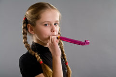 Cute girl with blowouts toy Stock Images