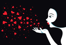 Cute girl blows with hands hearts. Air kiss. Stock Photography