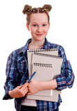Cute girl in a blue checkered shirt. Holding a blue pencil and notepads for drawing,  on a white background Stock Photo