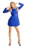Cute girl in blue coat Royalty Free Stock Images