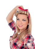 Cute girl with blue eyes in pinup style Stock Photo