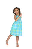 Cute girl in blue spring dress Stock Photography