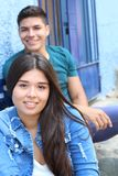 Cute girl with blurred boy in the background stock photography