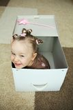 Cute Girl in Box Royalty Free Stock Images