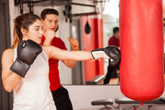 Cute girl boxing with a personal trainer Stock Photography