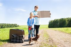 Cute girl and boy with dog  on road Royalty Free Stock Photography