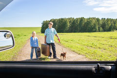 Cute girl and boy with dog  on road Stock Image