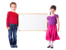 Cute girl and boy holding blank ad Stock Photo