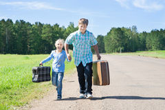 Cute girl and boy with suitcase Stock Photos