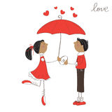 Cute girl and boy under umbrella Royalty Free Stock Photo