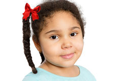 Cute Girl with Braided Curly Hair Looking at You. Close up Cute Young Girl with Braided Curly Hair Looking at You with Half Smile, Isolated on White Background Stock Photography