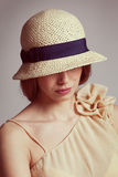 Cute girl in braided straw hat Royalty Free Stock Photo