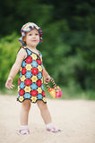 Cute girl with bright colorful dress Royalty Free Stock Photography