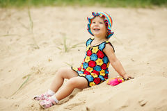 Cute girl with bright colorful dress Royalty Free Stock Image