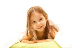Cute girl with brown eyes. Smile girl with brown eyes on the bed Stock Photos