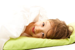 Cute girl with brown eyes. Cute little girl  in her bed Stock Photos