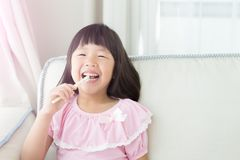 Cute girl brush teeth Stock Photos
