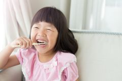 Cute girl brush teeth Royalty Free Stock Photo