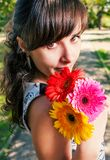 Cute girl with bunch of flowers head and shoulders Stock Photo