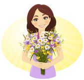 Cute girl with bunch of wild flowers Royalty Free Stock Photo