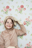 Cute Girl In Bunny Costume Against Wallpaper Stock Photography