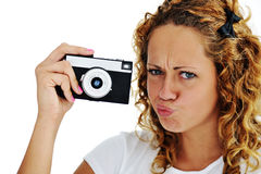 Cute girl with camera Stock Photos