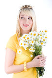 Cute girl with camomilles Royalty Free Stock Images