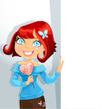 Cute girl with candy-heart keeps banner Stock Image
