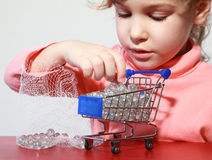 Cute girl care play with toy shopping trolley stock image