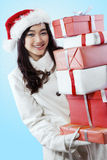 Cute girl carrying lots of presents Stock Images