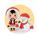 Cute Girl Celebrating Christmas with Snowman. Under  Snowfall in the Afternoon Royalty Free Stock Image