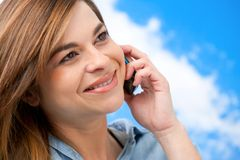 Cute girl on cellphone close up. Royalty Free Stock Photography