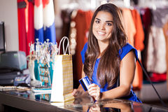 Cute girl at the checkout counter Royalty Free Stock Photo