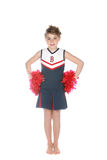 Cute girl in cheerleader outfit and pompoms Stock Image