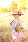 Cute girl with cherries. Cute kid girl holding basket with cherries outdoors Royalty Free Stock Photography