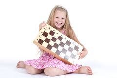 Cute girl with chess on white. The Cute girl with chess on white Stock Images