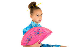 Cute girl in Chinese dress holding a fan Stock Photography