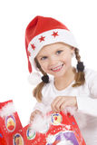 Cute girl and christmas gifts Stock Image