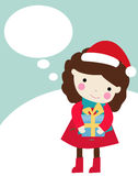 Cute girl and christmas present Royalty Free Stock Photos