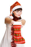 Cute girl with a Christmas sock Stock Photography