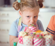 Cute girl with Christmas sweets at home Royalty Free Stock Photos
