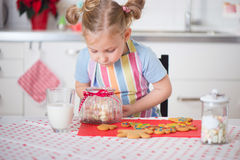 Cute girl with Christmas sweets at home Stock Photo