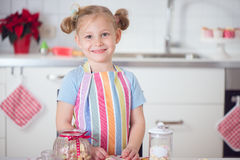 Cute girl with Christmas sweets at home Royalty Free Stock Photo