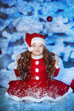 Cute girl and Christmas Tree Stock Photography